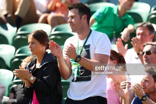 Nick Cavaday of Great Britain coach of Aljaz Bedene of Great Britain claps during the Gentlemen's Singles first round match between Aljaz Bedene of...