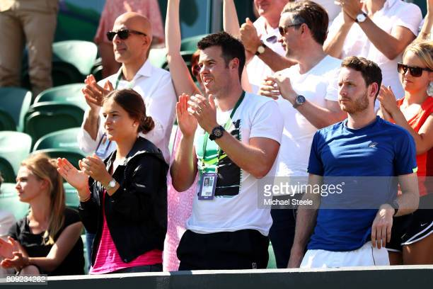Nick Cavaday of Great Britain coach of Aljaz Bedene of Great Britain claps Aljaz Bedene of Great Britain victory in the Gentlemen's Singles first...