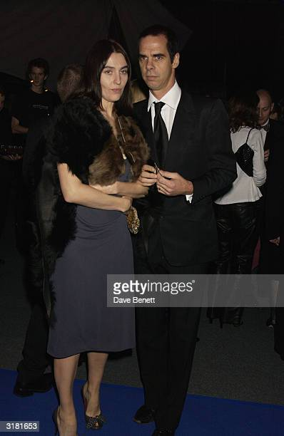 Nick Cave and guest attend the 'Master and Commander The Far Side Of The World' aftershow party at the Old Billingsgate Market on November 17 2003 in...