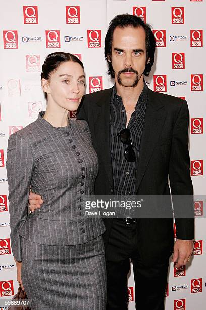 Nick Cave and his partner arrive at The Q Awards the annual magazine's music awards at Grosvenor House on October 10 2005 in London England
