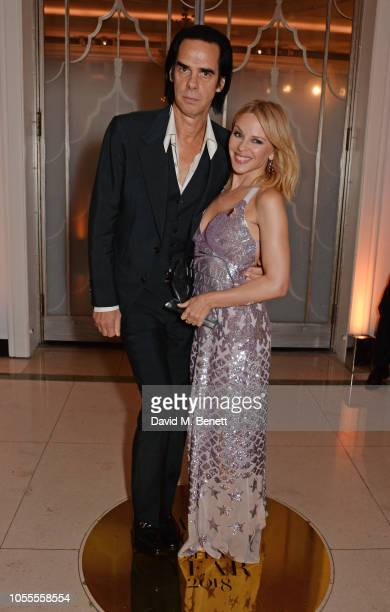 Nick Cave and Kylie Minogue attend the Harper's Bazaar Women Of The Year Awards 2018 in partnership with Michael Kors and MercedesBenz at Claridge's...