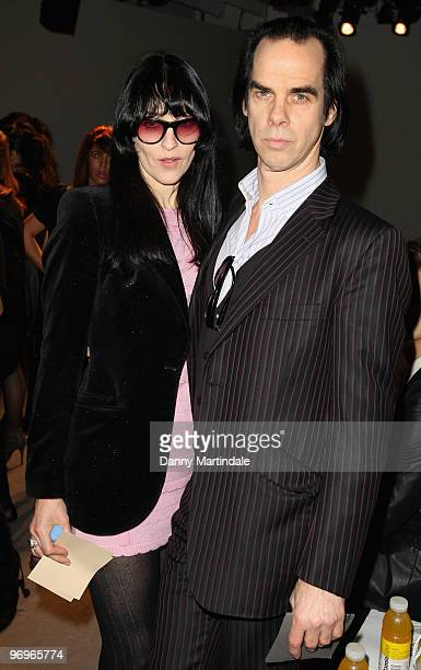 Nick Cave and wife Susie Bick pose on the front row at the Pam Hogg show for London Fashion Week Autumn/Winter 2010 at On|Off on February 22 2010 in...