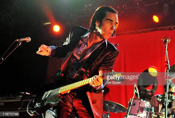 Nick Cave of Grinderman performs live on stage during the second night of the 'I'll Be Your Mirror' festival curated By Portishead ATP at Alexandra...