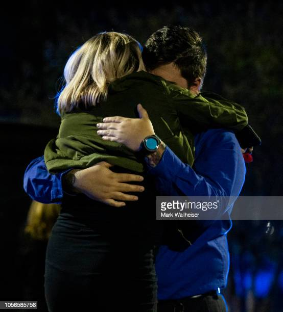 Nick Cessna right confronts his girlfriend Melissa Hutchinson who rendered aid to some of the victims of a mass shooting November 2 2018 in...