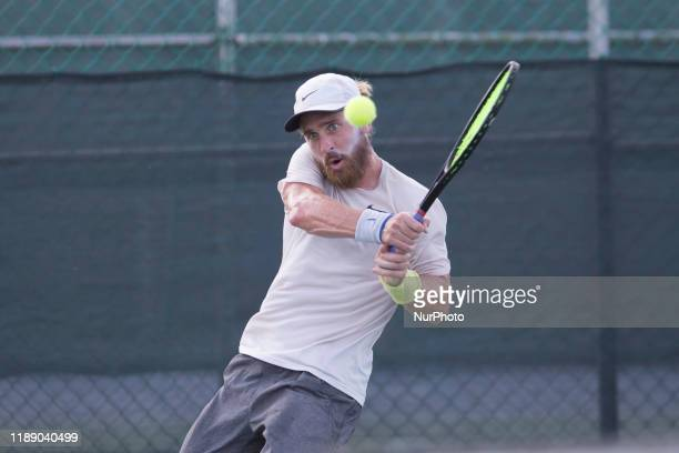 Nick Chappell of USA plays a backhand in the match Singles Finals against Vasil Kirkov of USA during The World Tennis Tournament Cancun 2019 on...