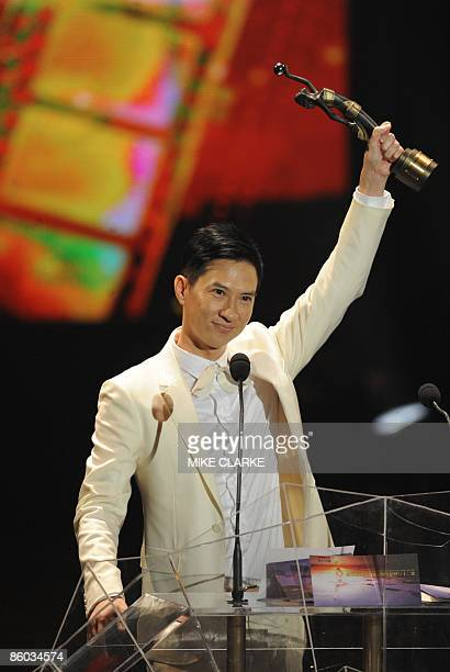 Nick Cheung holds aloft the Best Actor award at the Hong Kong Film Awards ceremony in Hong Kong on April 19 2009 The 28th Hong Kong Film Awards...