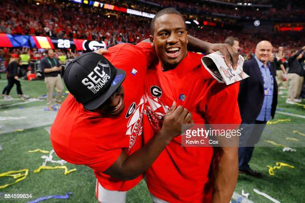 Nick Chubb and Sony Michel celebrate beating the Auburn Tigers in the SEC Championship at MercedesBenz Stadium on December 2 2017 in Atlanta Georgia