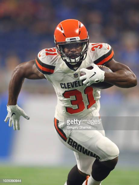 Nick Chubb of the Cleveland Browns battles for extras yards during a first quarter run while playing the Detroit Lions during a preseason game at...