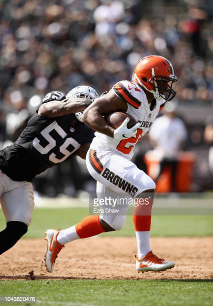 Nick Chubb of the Cleveland Browns breaks away from Tahir Whitehead of the Oakland Raiders on his was to scoring a touchdown at OaklandAlameda County...