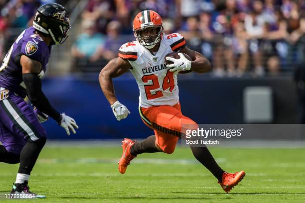 Nick Chubb of the Cleveland Browns carries the ball against Earl Thomas of the Baltimore Ravens during the first half at MT Bank Stadium on September...