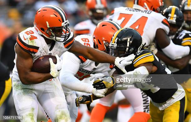 Nick Chubb of the Cleveland Browns carries the ball against Terrell Edmunds of the Pittsburgh Steelers during the second half in the game at Heinz...