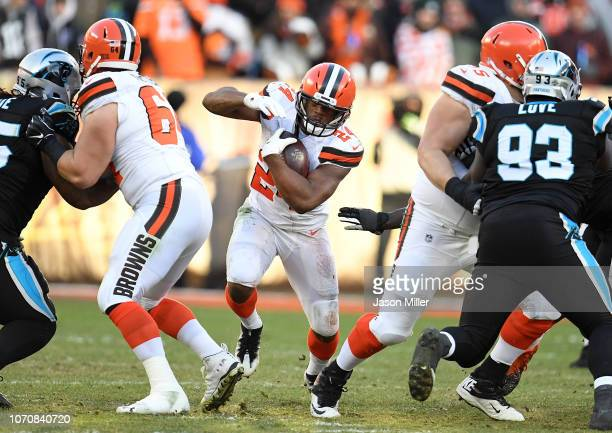 Nick Chubb of the Cleveland Browns carries the ball during the fourth quarter against the Carolina Panthers at FirstEnergy Stadium on December 9 2018...