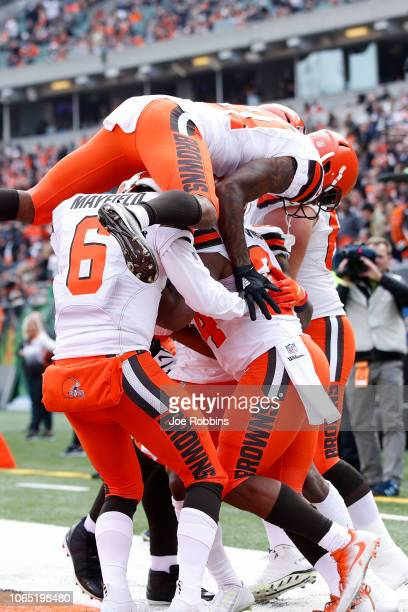 Nick Chubb of the Cleveland Browns is congratulated by his teammates after scoring a touchdown during the second quarter of the game against the...
