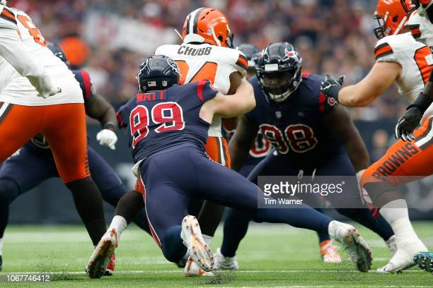 Nick Chubb of the Cleveland Browns is stopped for a loss by JJ Watt of the Houston Texans in the third quarter at NRG Stadium on December 2 2018 in...