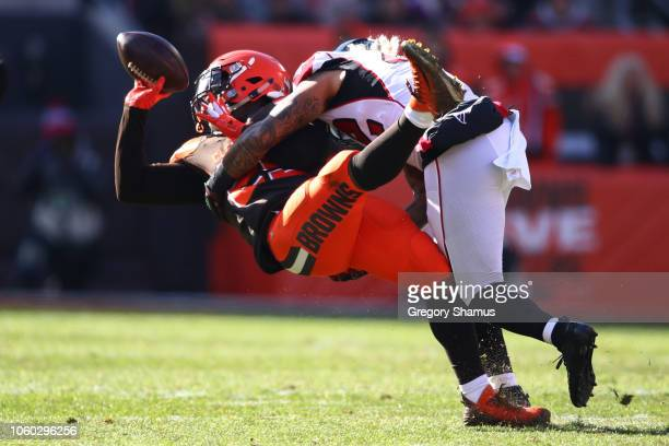 Nick Chubb of the Cleveland Browns is tackled by Duke Riley of the Atlanta Falcons in the first half at FirstEnergy Stadium on November 11 2018 in...