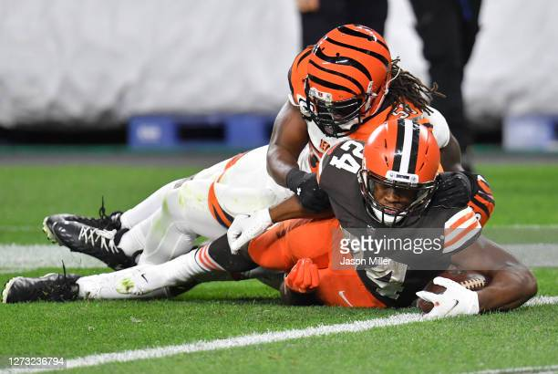 Nick Chubb of the Cleveland Browns is tackled short of the end zone by Josh Bynes of the Cincinnati Bengals during the second half at FirstEnergy...