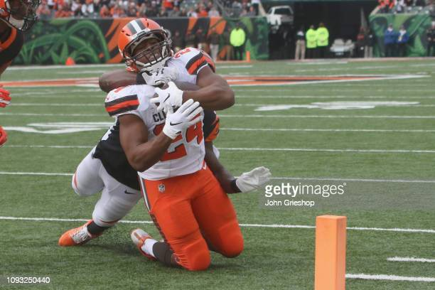 Nick Chubb of the Cleveland Browns reaches for the pylon during the game against the Cincinnati Bengals at Paul Brown Stadium on November 25 2018 in...