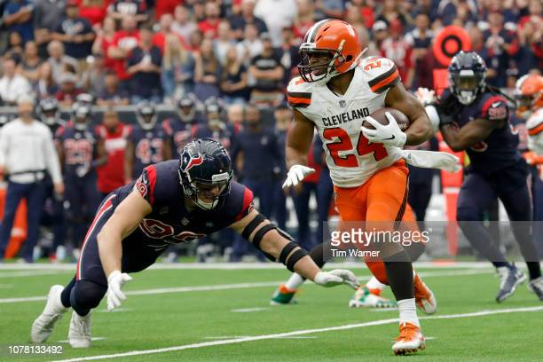 Nick Chubb of the Cleveland Browns runs the ball as JJ Watt of the Houston Texans looks to make a tackle in the first quarter at NRG Stadium on...