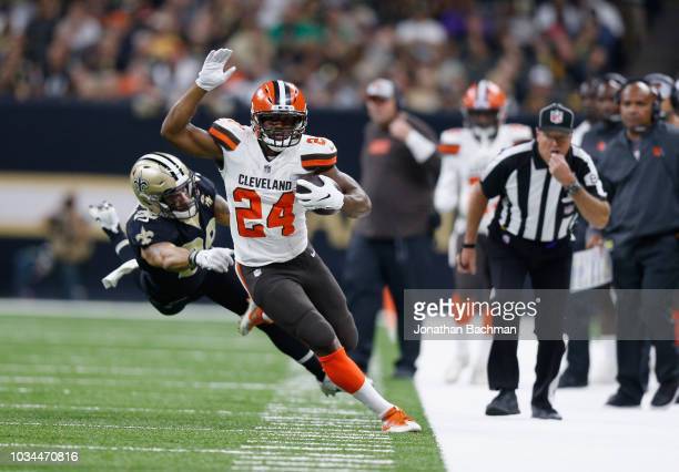 Nick Chubb of the Cleveland Browns runs the ball as Kurt Coleman of the New Orleans Saints defends during the fourth quarter at MercedesBenz...