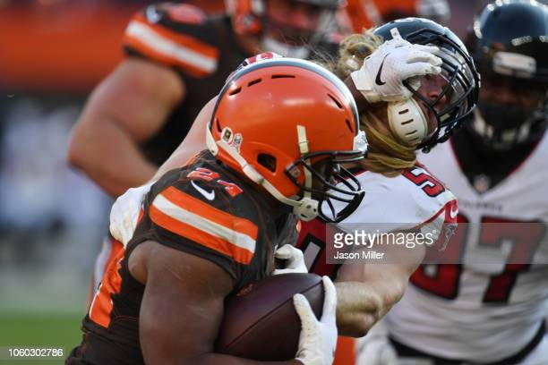 Nick Chubb of the Cleveland Browns runs the ball defended by Brooks Reed of the Atlanta Falcons at FirstEnergy Stadium on November 11 2018 in...