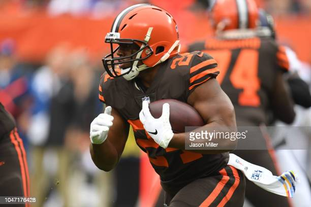 Nick Chubb of the Cleveland Browns runs the ball in the first half against the Baltimore Ravens at FirstEnergy Stadium on October 7 2018 in Cleveland...