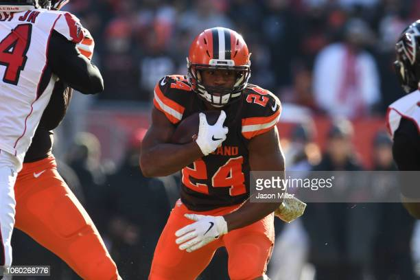 Nick Chubb of the Cleveland Browns runs the ball in the third quarter against the Atlanta Falcons at FirstEnergy Stadium on November 11 2018 in...