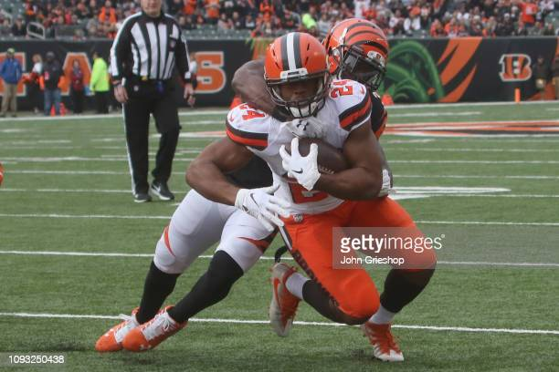 Nick Chubb of the Cleveland Browns runs the football upfield during the game against the Cincinnati Bengals at Paul Brown Stadium on November 25 2018...