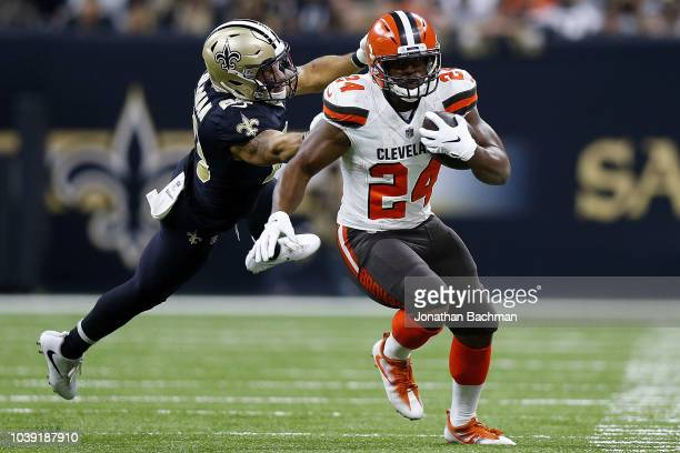 Nick Chubb of the Cleveland Browns runs with the ball as Kurt Coleman of the New Orleans Saints defends during a game at the MercedesBenz Superdome...