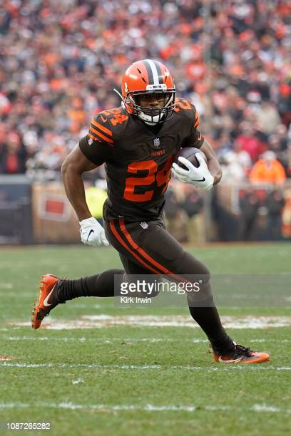 Nick Chubb of the Cleveland Browns runs with the ball during the game against the Cincinnati Bengals at FirstEnergy Stadium on December 23 2018 in...