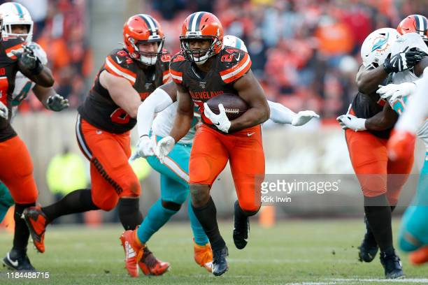 Nick Chubb of the Cleveland Browns runs with the ball during the fourth quarter of the game against the Miami Dolphins at FirstEnergy Stadium on...