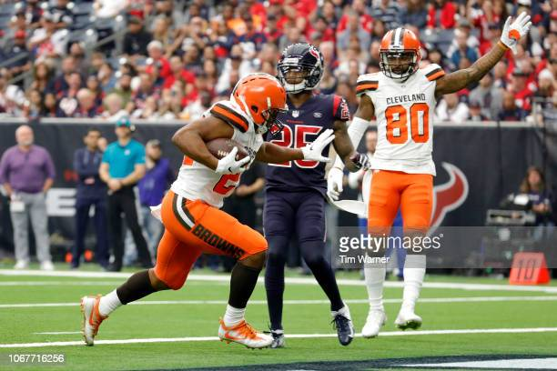 Nick Chubb of the Cleveland Browns rushes for a touchdown defended by Kareem Jackson of the Houston Texans in the third quarter at NRG Stadium on...