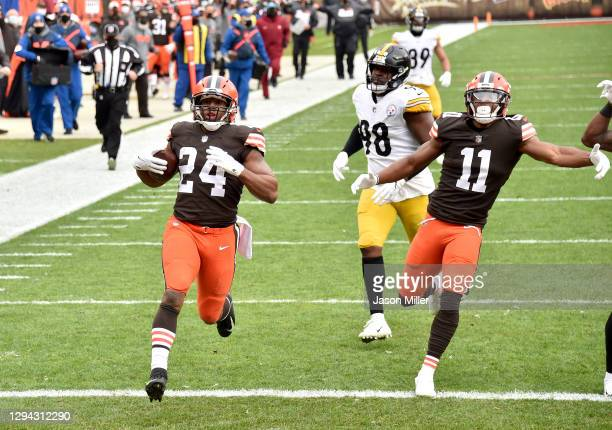 Nick Chubb of the Cleveland Browns scores a touchdown against the Pittsburgh Steelers in the first quarter at FirstEnergy Stadium on January 03, 2021...