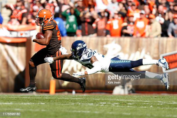 Nick Chubb of the Cleveland Browns slips past an attempted tackle by Bradley McDougald of the Seattle Seahawks during the first quarter at...