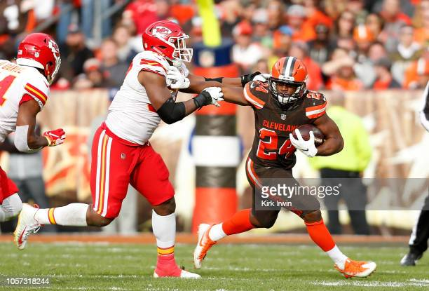 Nick Chubb of the Cleveland Browns stiff arms Breeland Speaks of the Kansas City Chiefs during the third quarter at FirstEnergy Stadium on November 4...