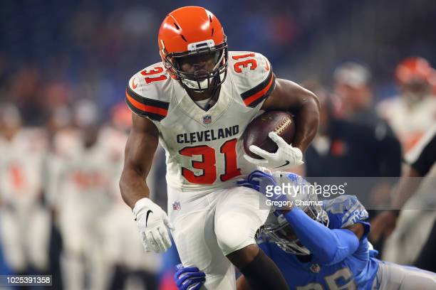 Nick Chubb of the Cleveland Browns tries to escape the tackle of DeShawn Shead of the Detroit Lions during a preseason game at Ford Field on August...