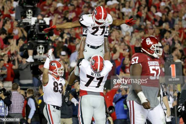 Nick Chubb of the Georgia Bulldogs and Isaiah Wynn celebrate after Chubb scores a touchdown in the 2018 College Football Playoff Semifinal Game...