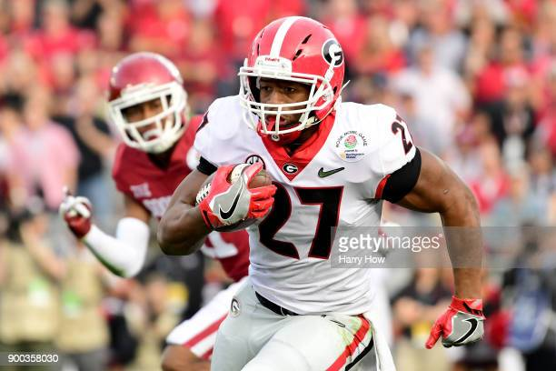 Nick Chubb of the Georgia Bulldogs carries for a 45 yard gain in the 2018 College Football Playoff Semifinal Game against the Oklahoma Sooners at the...