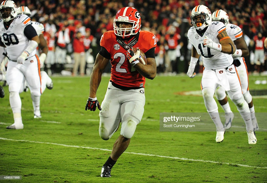 Nick Chubb #27 of the Georgia Bulldogs carries the ball against the Auburn Tigers at Sanford Stadium on November 15, 2014 in Athens, Georgia.