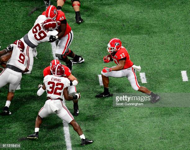 Nick Chubb of the Georgia Bulldogs carries the ball against the Alabama Crimson Tide in the CFP National Championship presented by ATT at...