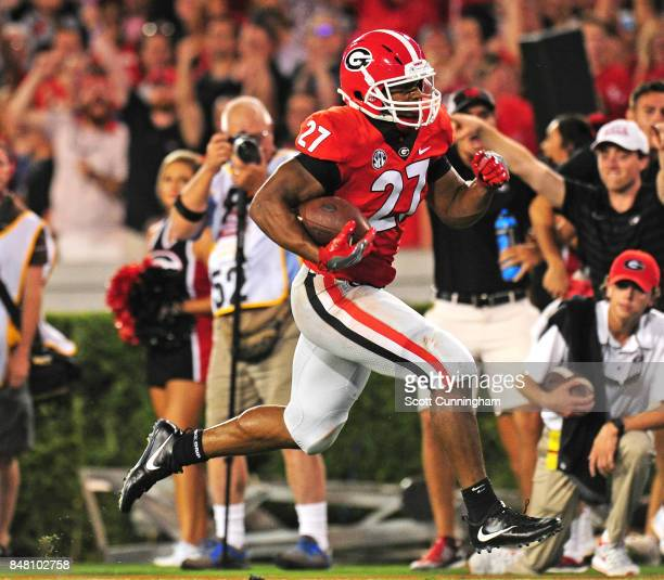 Nick Chubb of the Georgia Bulldogs carries the ball for a 32 yard touchdown against the Samford Bulldogs at Sanford Stadium on September 16 2017 in...