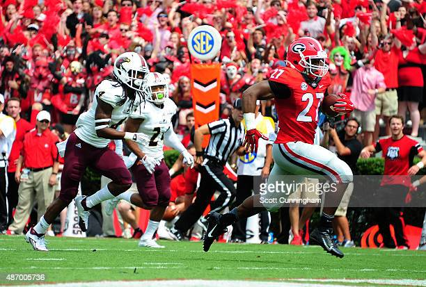 Nick Chubb of the Georgia Bulldogs carries the ball for a first quarter touchdown against Louisiana Monroe Warhawks on September 5 2015 in Atlanta...