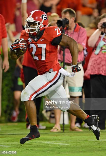 Nick Chubb of the Georgia Bulldogs carries the ball for a fourth quarter touchdown against the Clemson Tigers at Sanford Stadium on August 30 2014 in...