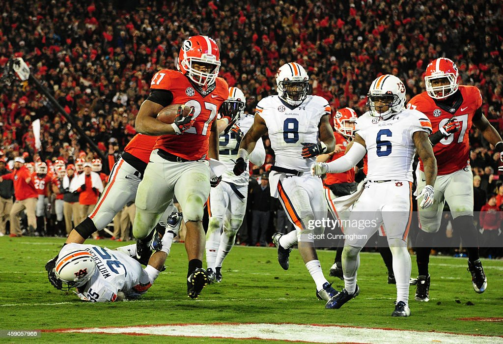 Nick Chubb #27 of the Georgia Bulldogs carries the ball for a second half touchdown against the Auburn Tigers at Sanford Stadium on November 15, 2014 in Athens, Georgia.