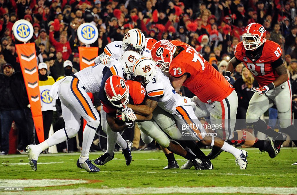 Nick Chubb #27 of the Georgia Bulldogs carries the ball for a second quarter touchdown against Jonathan Jones #3 of the Auburn Tigers at Sanford Stadium on November 15, 2014 in Athens, Georgia.