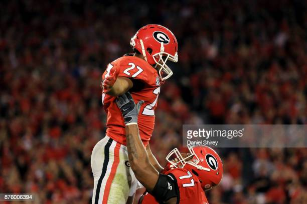 Nick Chubb of the Georgia Bulldogs celebrates a touchdown with Isaiah Wynn during the second half against the Kentucky Wildcats at Sanford Stadium on...