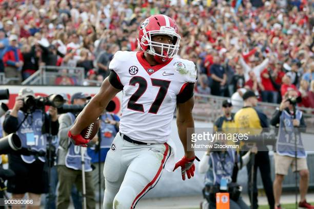 Nick Chubb of the Georgia Bulldogs celebrates after a 50yard touchdown in the third quarter in the 2018 College Football Playoff Semifinal Game...