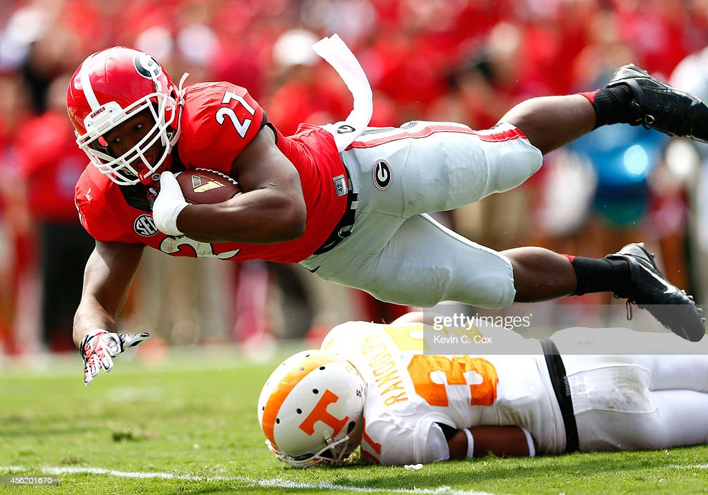 Nick Chubb #27 of the Georgia Bulldogs dives for a touchdown over Brian Randolph #37 of the Tennessee Volunteers at Sanford Stadium on September 27, 2014 in Athens, Georgia.