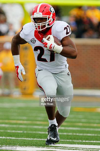 Nick Chubb of the Georgia Bulldogs drives up the field against the Missouri Tigers in the first half on October 11 2014 at Faurot Field/Memorial...