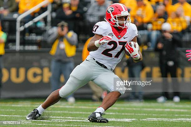 Nick Chubb of the Georgia Bulldogs drives up the field against the Missouri Tigers defense in the second half on October 11 2014 at Faurot...