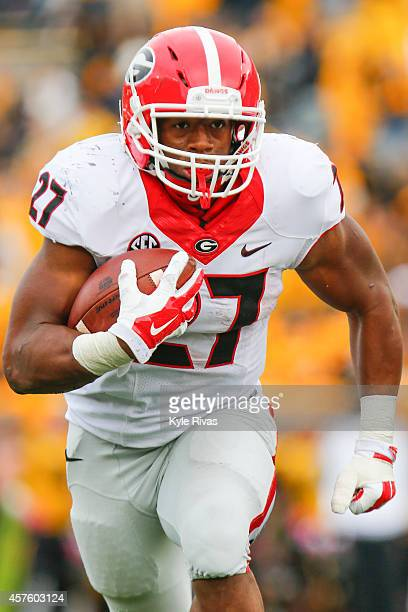Nick Chubb of the Georgia Bulldogs moves past the Missouri Tigers defense in the second half on October 11 2014 at Faurot Field/Memorial Stadium in...